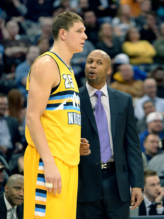 . DENVER, CO. - FEBRUARY 27, 2014: Denver coach Brian Shaw had a word with center Timofey Mozgov in the first half. The Denver Nuggets hosted the Brooklyn Nets at the Pepsi Center Thursday night, February 27, 2014. Photo By Karl Gehring/The Denver Post