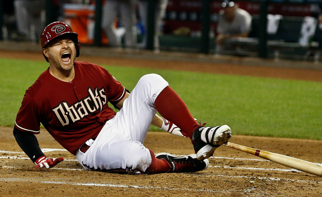 . Arizona Diamondbacks\' Cody Ross reacts after fouling a ball off his foot in the first inning during a baseball game against the Colorado Rockies, Sunday, April 28, 2013, in Phoenix. (AP Photo/Ross D. Franklin)