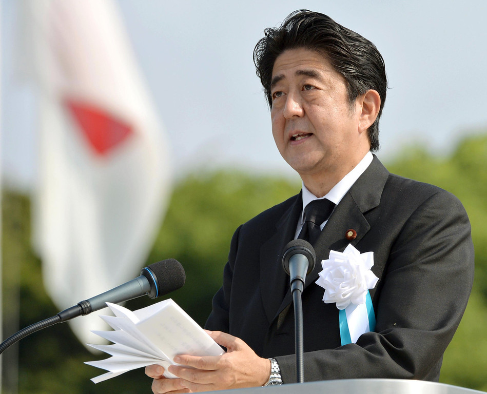 . Japan\'s Prime Minister Shinzo Abe delivers his speech at the Hiroshima Peace Memorial Park during the ceremony to mark the 68th anniversary of the atomic bombing of Hiroshima, western Japan, Tuesday, Aug. 6, 2013. (AP Photo/Kyodo News)