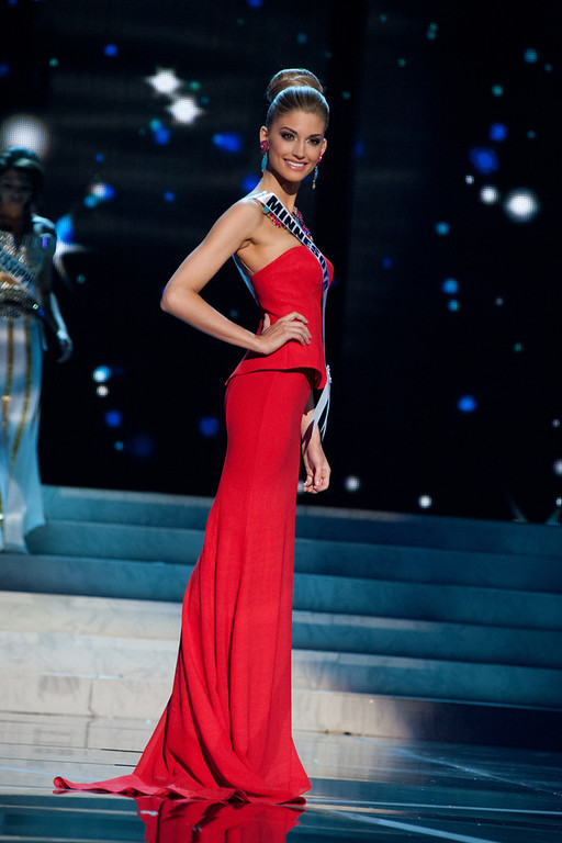 . This photo provided by the Miss Universe Organization, Miss Minnesota USA 2013, Danielle Hooper competes in her evening gown during the 2013 Miss USA Competition Preliminary Show  in Las Vegas  on Wednesday June 12, 2013.  She will compete for the title of Miss USA 2013 and the coveted Miss USA Diamond Nexus Crown on June 16, 2013.  (AP Photo/Miss Universe Organization, Patrick Prather)