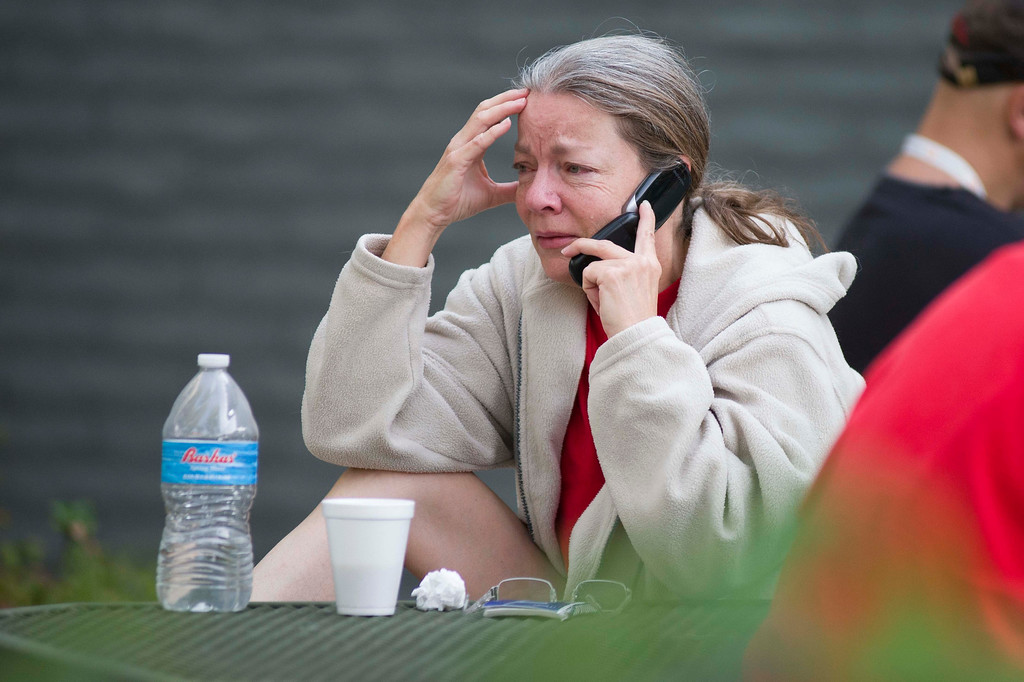 . Nancy Myers is emotional as she speaks to her boss to let him know that she won\'t be able to make it into work due to the Yarnell Hill Fire on Monday, July 1, 2013, at the Red Cross Shelter in Prescott, Ariz.      (AP Photo/The Arizona Republic, Aaron Lavinsky)