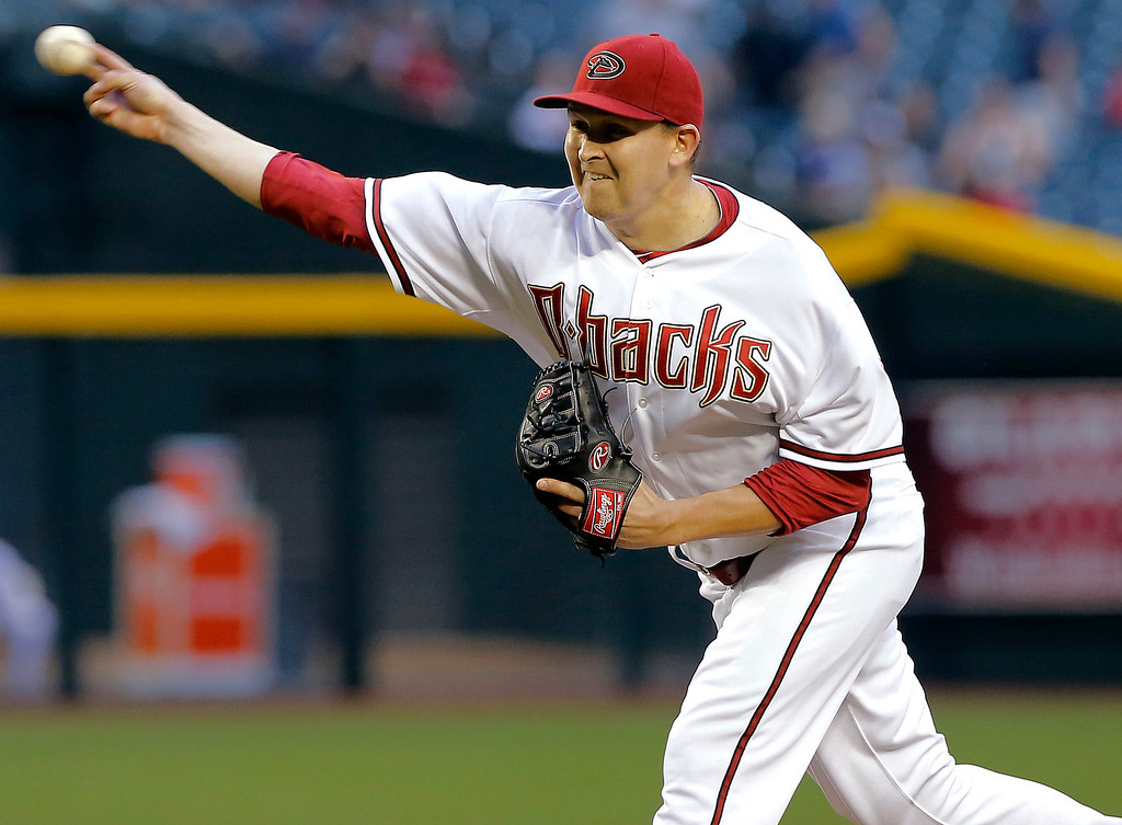 . Arizona Diamondbacks\' Trevor Cahill delivers a pitch against the Colorado Rockies during first the inning of a baseball game, Thursday, April 25, 2013, in Phoenix. (AP Photo/Matt York)