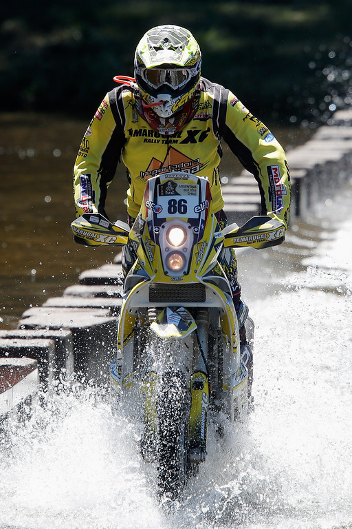 . Cristian Naser Colombo of Chile for KTM Tamarugal Honda Racing XC Rally Team competes on Day 1 of the Dakar Rally 2014 on January 5, 2014 in Santa Rosa de Calamuchita, Argentina.  (Photo by Dean Mouhtaropoulos/Getty Images)