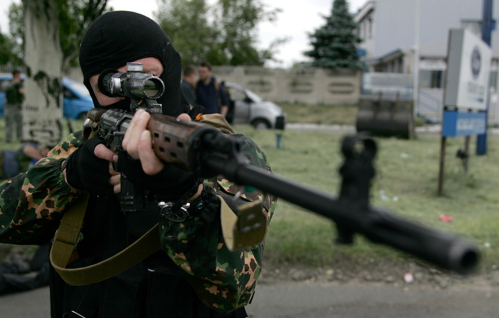 . A Pro-Russian militia man poses aiming his sniper rifle in Donetsk, eastern Ukraine, on Friday, May 23, 2014.  At least three people died when Ukrainian national guard unit and pro-Russian militiamen fought in the village of Karlivka early Friday. (AP Photo/Alexander Ermochenko)