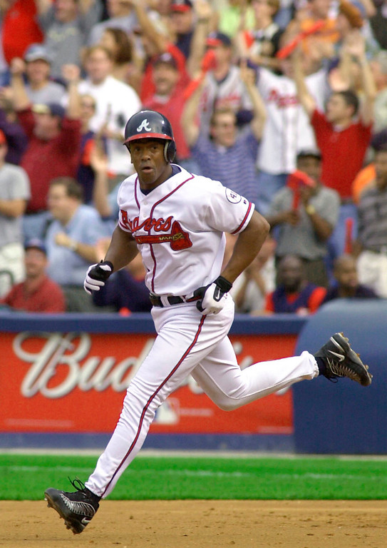 . JULIO FRANCO -- Atlanta Braves fans cheer Julio Franco rounds the bases after hitting a solo home run in the third inning off Houston Astros pitcher Shane Reynolds in Game 3 of the National League Division Series in Atlanta on Oct. 12, 2001.   (AP Photo/Gene Puskar)