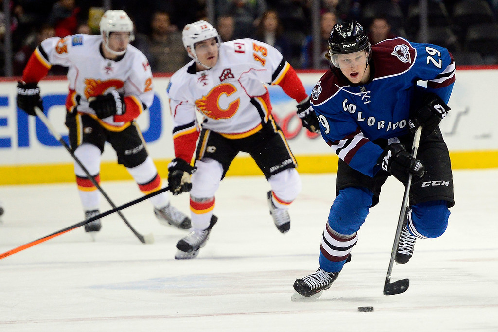 . Nathan MacKinnon (29) of the Colorado Avalanche controls the puck en route to two first-period goals against the Calgary Flames during the first period.   (Photo by AAron Ontiveroz/The Denver Post)