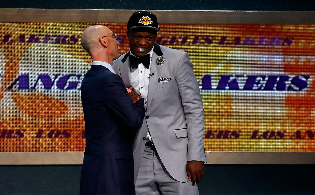 . Julius Randle (R) of Kentucky shakes hands NBA Commissioner Adam Silver after being selected with the #7 overall pick by the Los Angeles Lakers during the 2014 NBA Draft at Barclays Center on June 26, 2014 in the Brooklyn borough of New York City.   (Photo by Mike Stobe/Getty Images)