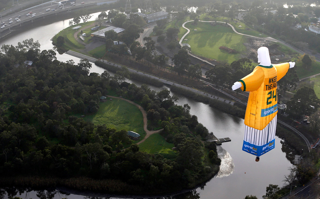 . In this photo provided sportsbet.com.au, a hot air balloon in the likeness of Brazil\'s Christ The Redeemer statute, wearing the colors of Australia\'s soccer team floats over the Melbourne skyline Tuesday, June 10, 2014. Australia will begin their 2014 soccer World Cup campaign with a match against Chile Saturday, in Cuiaba. (AP Photo/sportsbet.com.au, Dave Callow)