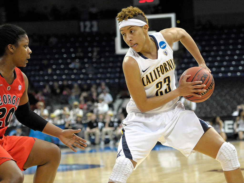 . California\'s Layshia Clarendon (23) prepares to drive Georgia\'s Shacobia Barbee (20) during the first half in a regional final in the NCAA women\'s college basketball tournament, Monday, April 1, 2013, in Spokane, Wash. (AP Photo/Jed Conklin)