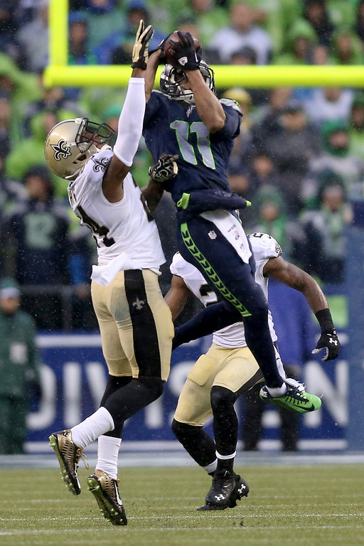 . SEATTLE, WA - JANUARY 11:  Wide receiver Percy Harvin #11 of the Seattle Seahawks makes a catch against cornerback Corey White #24 of the New Orleans Saints in the second quarter during the NFC Divisional Playoff Game at CenturyLink Field on January 11, 2014 in Seattle, Washington.  (Photo by Jeff Gross/Getty Images)