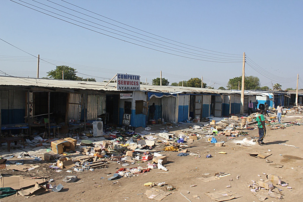 . A picture taken on December 25, 2013 shows the aftermath of massive looting conducted by rebels at a market, including shops burnt to ashes, in Bor, some 200 kilometers (125 miles) north of the capital Juba. South Sudan\'s army stormed the rebel-held town of Bor on December 24, sending insurgents fleeing nearly a week after they captured the state capital of South Sudan\'s power-key eastern state of Jonglei.   WAAKHE SIMON WUDU/AFP/Getty Images
