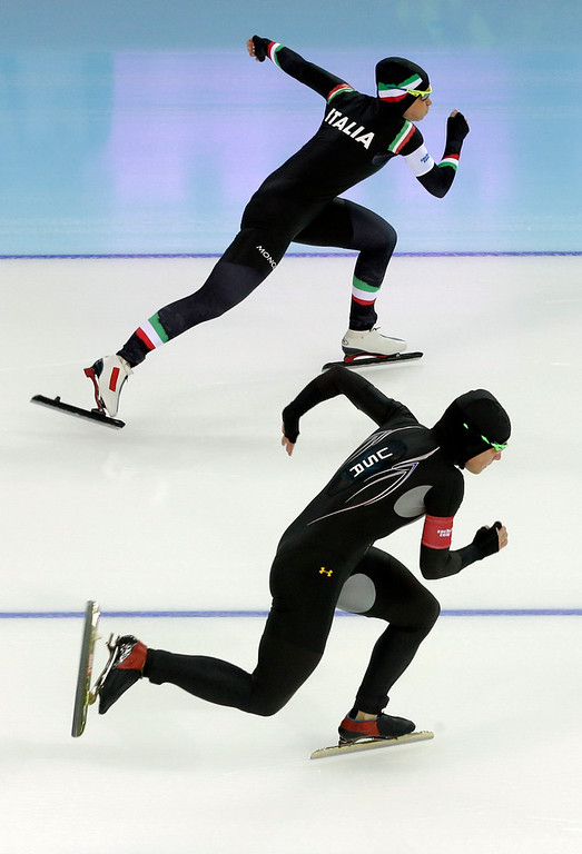 . Yvonne Daldossi of Italy, top, and Sugar Todd of the U.S. compete in the first heat of the women\'s 500-meter speed skating race at the Adler Arena Skating Center at the 2014 Winter Olympics, Tuesday, Feb. 11, 2014, in Sochi, Russia. (AP Photo/Patrick Semansky)