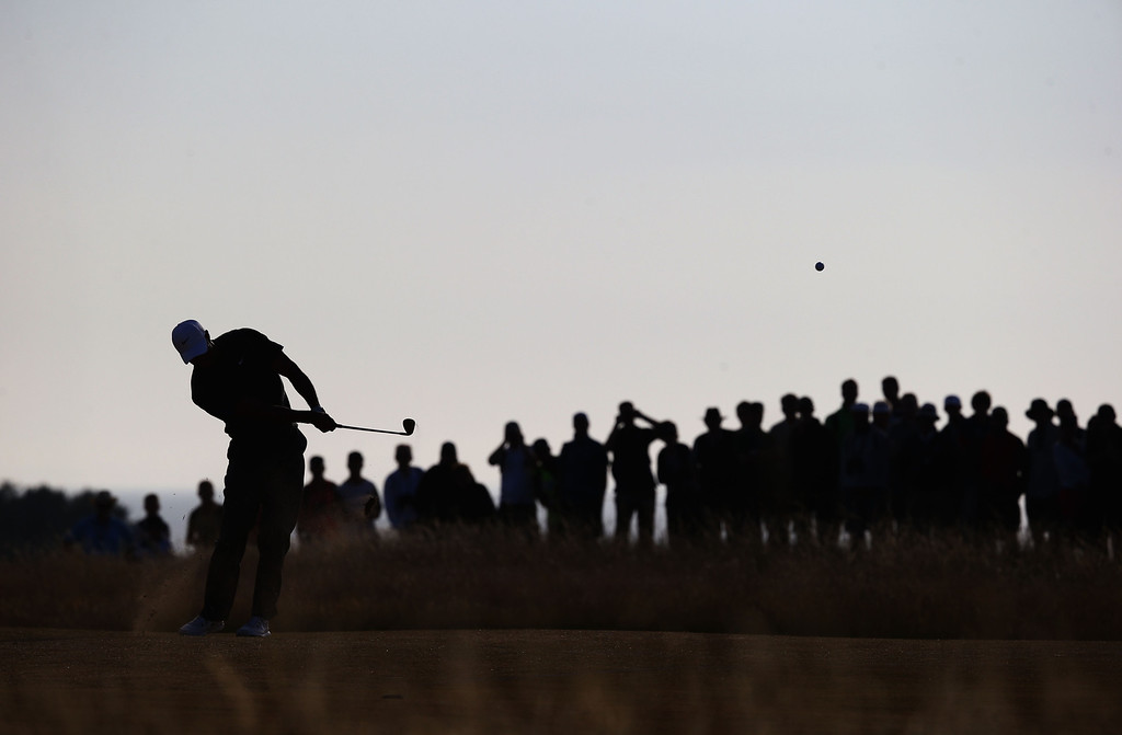 . GULLANE, SCOTLAND - JULY 20:  Tiger Woods of the United States hits a chip shot on the 17th during the third round of the 142nd Open Championship at Muirfield on July 20, 2013 in Gullane, Scotland.  (Photo by Matthew Lewis/Getty Images)