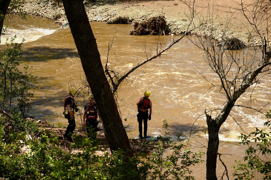 . Rescue crews look for people in the river near Lyons after a raft was found with no one inside, May 27, 2014. So fare no one has been found. (Photo by RJ Sangosti/The Denver Post)
