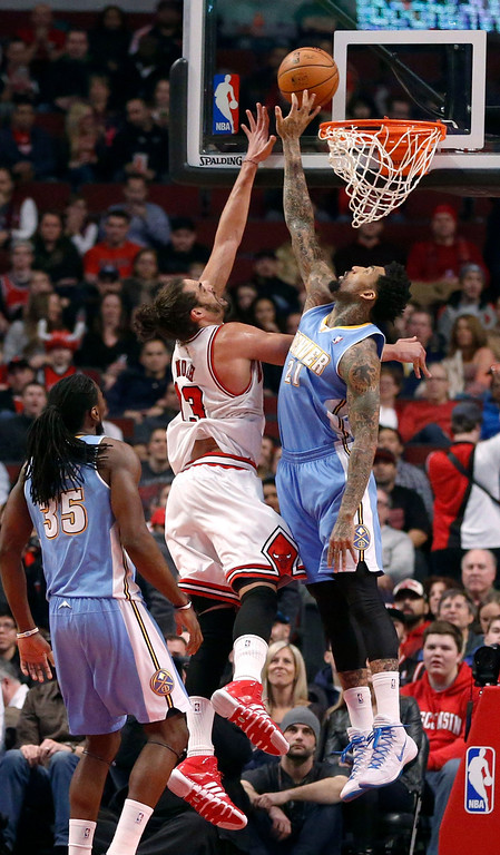 . Denver Nuggets forward Anthony Randolph (15) blocks the shot of Chicago Bulls center Joakim Noah during the first half of an NBA basketball game Friday, Feb. 21, 2014, in Chicago. (AP Photo/Charles Rex Arbogast)