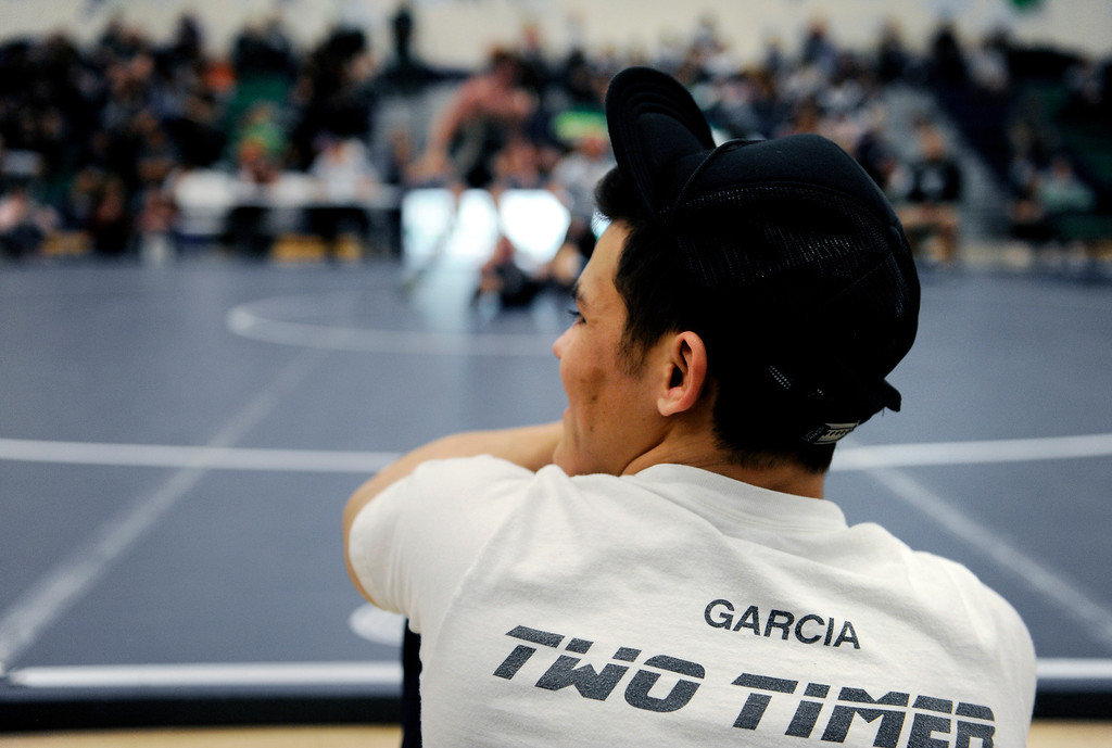. P.T. Garcia, 18, a senior at Bear Creek High School, competes in the Commanders Invitation Wrestling Tournament at John F. Kennedy High School on Jan. 25, in hopes to achieve his third straight state title. Photo by Jamie Cotten, Special to The Denver Post