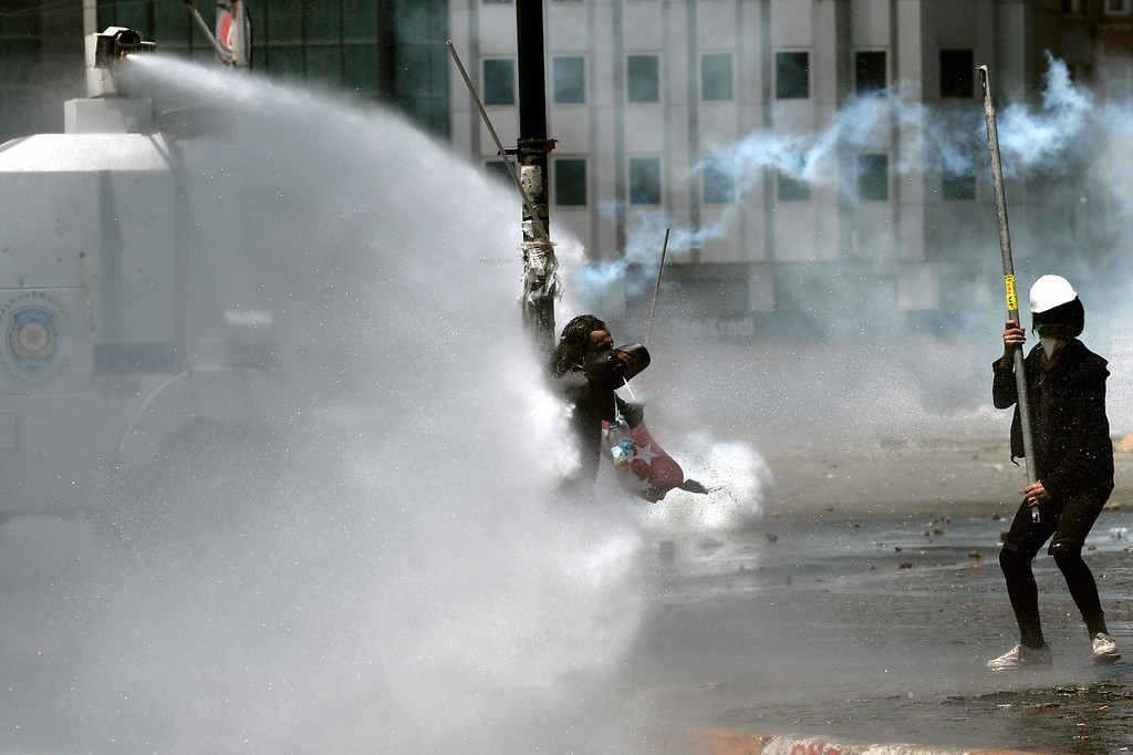. A protester is hit by water cannons at Istanbul\'s Taksim square, the epicenter of nearly two weeks of anti-government demos, during clashes with riot police on June 11, 2013.      AFP PHOTO / ARIS MESSINIS/AFP/Getty Images