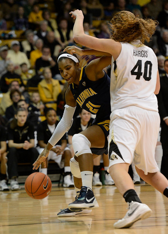 . California Golden Bears forward Reshanda Gray (21) drives on Colorado Buffaloes center Rachel Hargis (40) during the first half Sunday, January 6, 2013 at Coors Events Center. John Leyba, The Denver Post