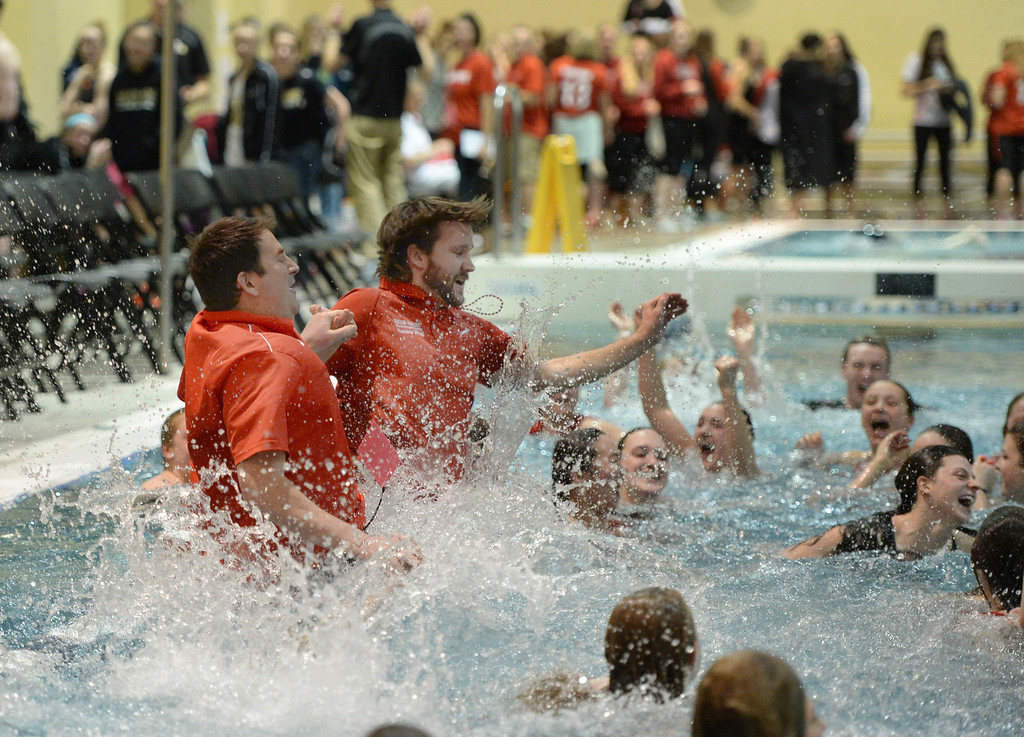 . THORNTON, CO. - FEBRUARY 15, 2014: The Regis Jesuit coaches joined the team in the pool after the Raiders secured the team title Saturday. The CHSAA 5A Girl\'s State Swimming Championships wrapped up Saturday night February 14, 2104.  Photo By Karl Gehring/The Denver Post