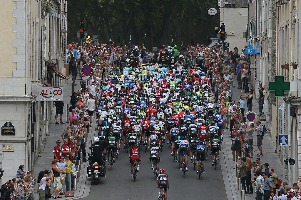 . The peloton passes through the street of Pau as they begin the eighteenth stage of the 2014 Tour de France, a 146km stage between Pau and Hautacam, on July 24, 2014 in Pau, France.  (Photo by Doug Pensinger/Getty Images)