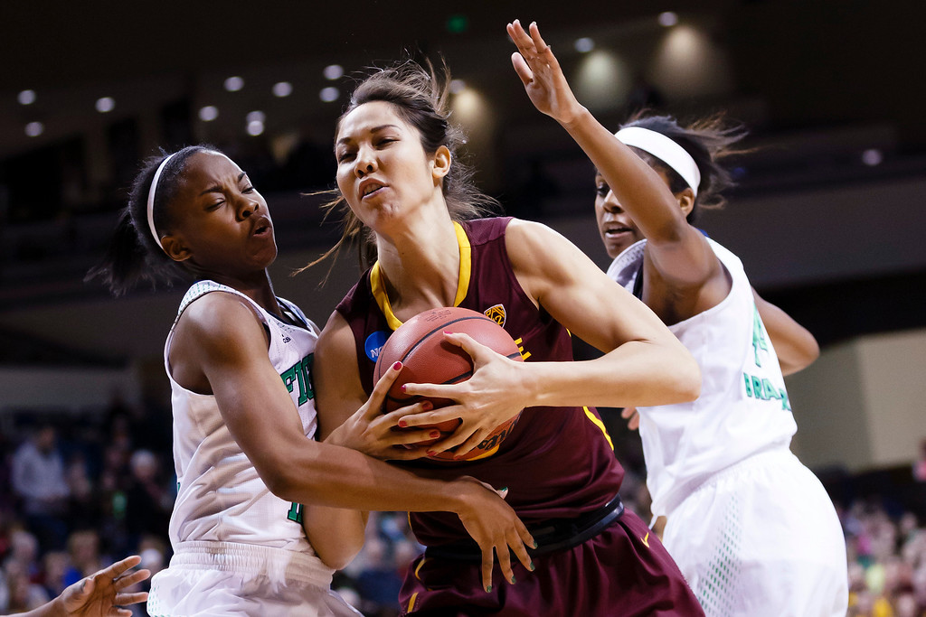 . Notre Dame guard Lindsay Allen, left, Arizona State center Joy Burke, center, and Notre Dame forward Ariel Braker, right, go after the rebound during the first half in a second-round game in the NCAA women\'s college basketball tournament in Toledo, Ohio, Monday, March 24, 2014. (AP Photo/Rick Osentoski)
