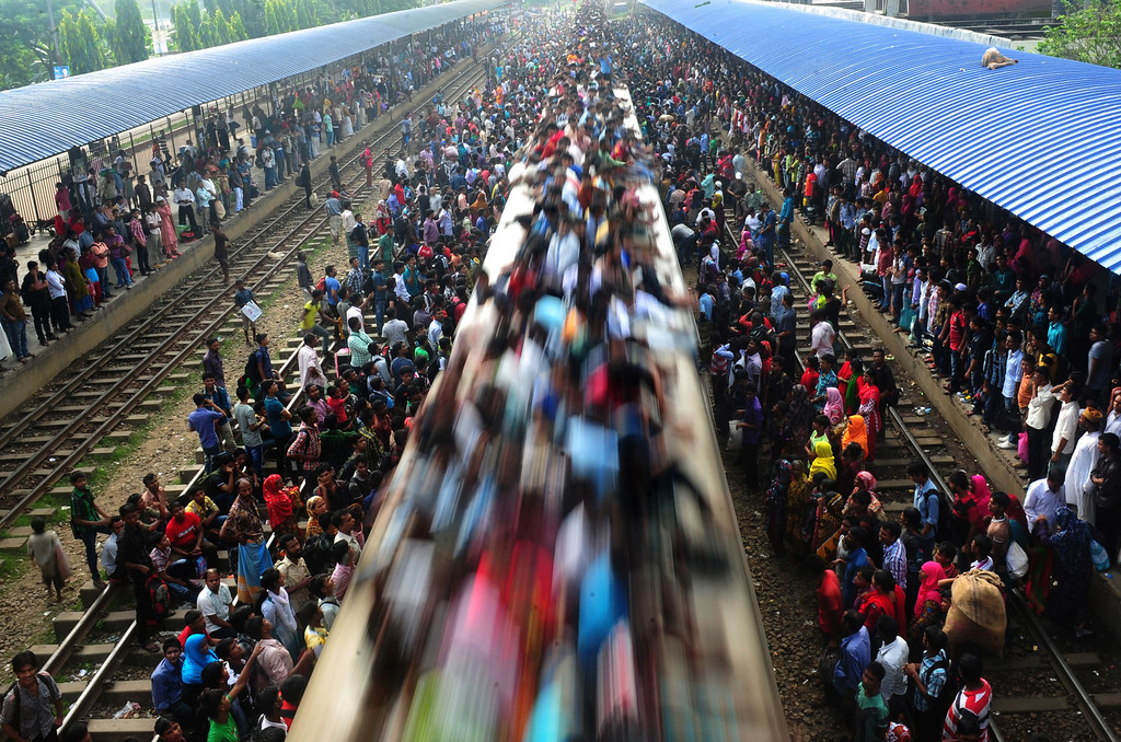 . Bangladeshi commuters ride on a train as they rush home to be with their families in remote villages, ahead of the Muslim festival of Eid al-Adha, in Dhaka on October 15, 2013.  AFP PHOTO/ Munir UZ ZAMAN/AFP/Getty Images
