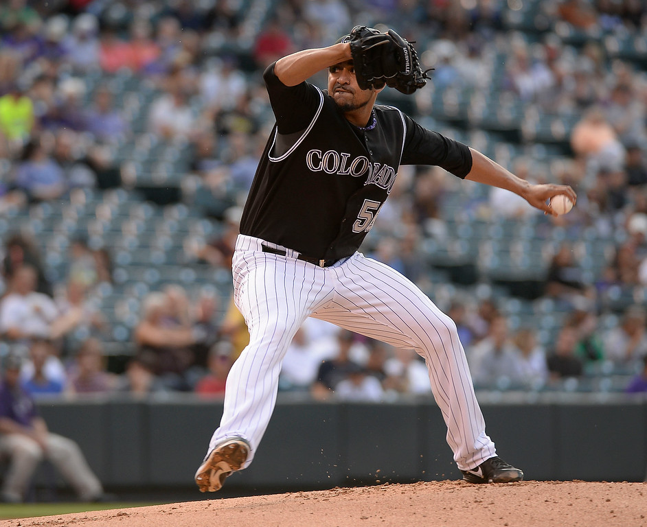 . Colorado Rockies starting pitcher Franklin Morales (56) delivers a pitch in the first inning against the San Diego Padres July 8, 2014 at Coors Field. (Photo by John Leyba/The Denver Post)