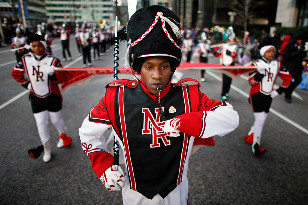. Drum Major Benjamin Littlejohn leads the Nansemond River High School Magnificent Marching Warrior Band during the 94th annual Thanksgiving day parade, Thursday Nov. 28, 2013, in Philadelphia. Officials say gusty winds limited use of balloons during parade. The National Weather Service reported winds of about 17 miles per hour gusting to 28 miles per hour at Philadelphia International Airport. (AP Photo/ Joseph Kaczmarek)