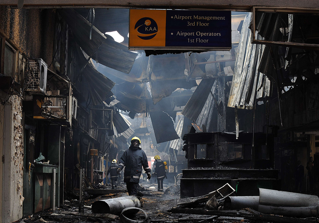 . A fire fighter walks among the debris after a fire damaged a terminal at the Jomo Kenyatta International airport in Nairobi on August 7, 2013.   AFP PHOTO / Tony  KARUMBA/AFP/Getty Images