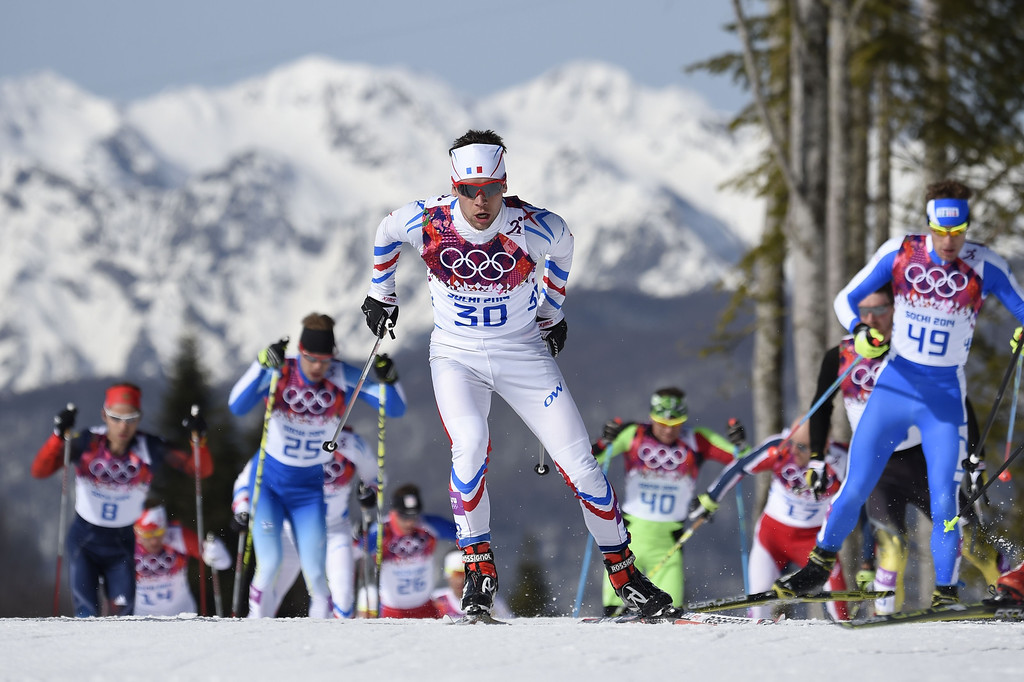 . France\'s Ivan Perrillat Boiteux (C) competes during the Men\'s Cross-Country Skiing 50km Mass Start Free at the Laura Cross-Country Ski and Biathlon Center during the Sochi Winter Olympics on February 23, 2014, in Rosa Khutor, near Sochi.  ODD ANDERSEN/AFP/Getty Images