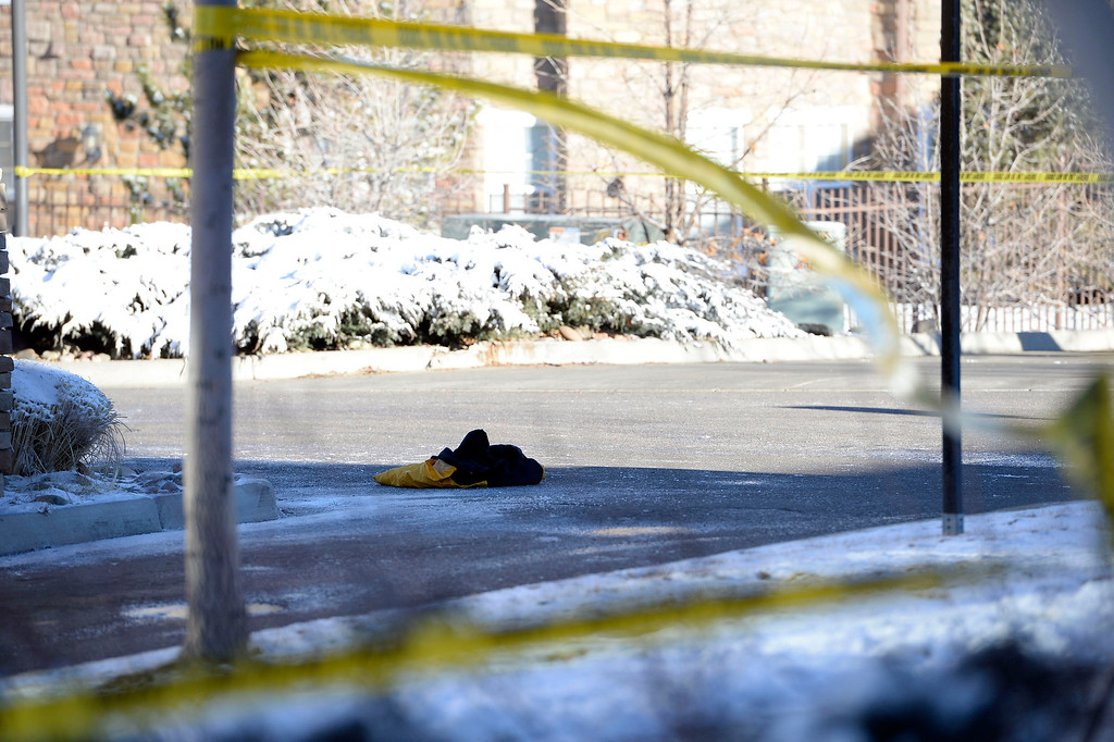 . The suspects jacket he took off after fleeing the intersection of Peoria and Lincoln where he abounded a car he carjacked after causing a crash. He was captured just a few yards away.  (Photo by John Leyba/The Denver Post)