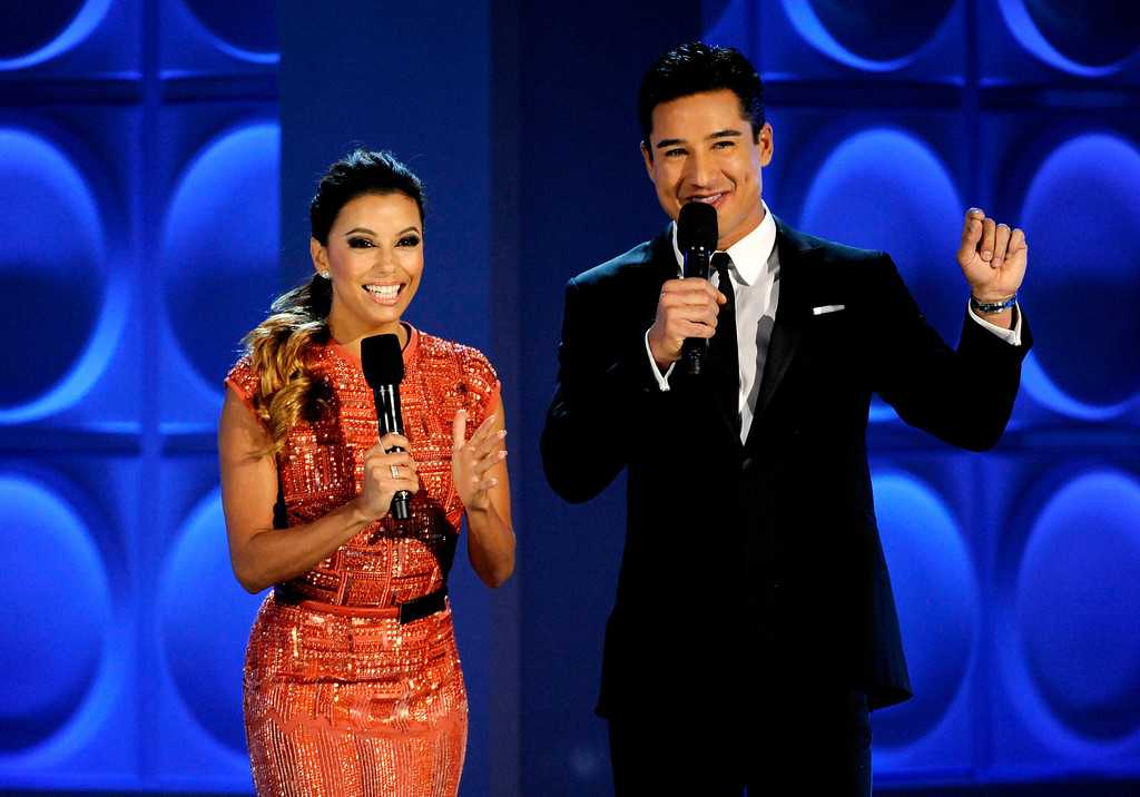 . Eva Longoria, left, and Mario Lopez speak on stage at the NCLR ALMA Awards at the Pasadena Civic Auditorium on Friday, Sept. 27, 2013, in Pasadena, Calif. (Photo by Paul Hebert/Invision/AP)