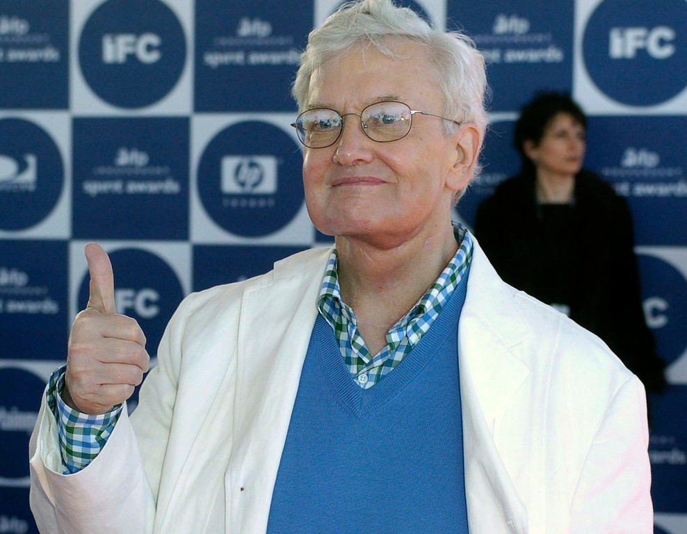 ". Film critic Roger Ebert gives thumbs up as he arrives for the 2004 IFP Independent Spirit Awards in Santa Monica, Calif., in a Saturday, Feb. 28, 2004 file photo. Roger Ebert has turned thumbs down on thumbs on ""At the Movies with Ebert & Roeper.\""(AP Photo/Chris Pizzello, file)"