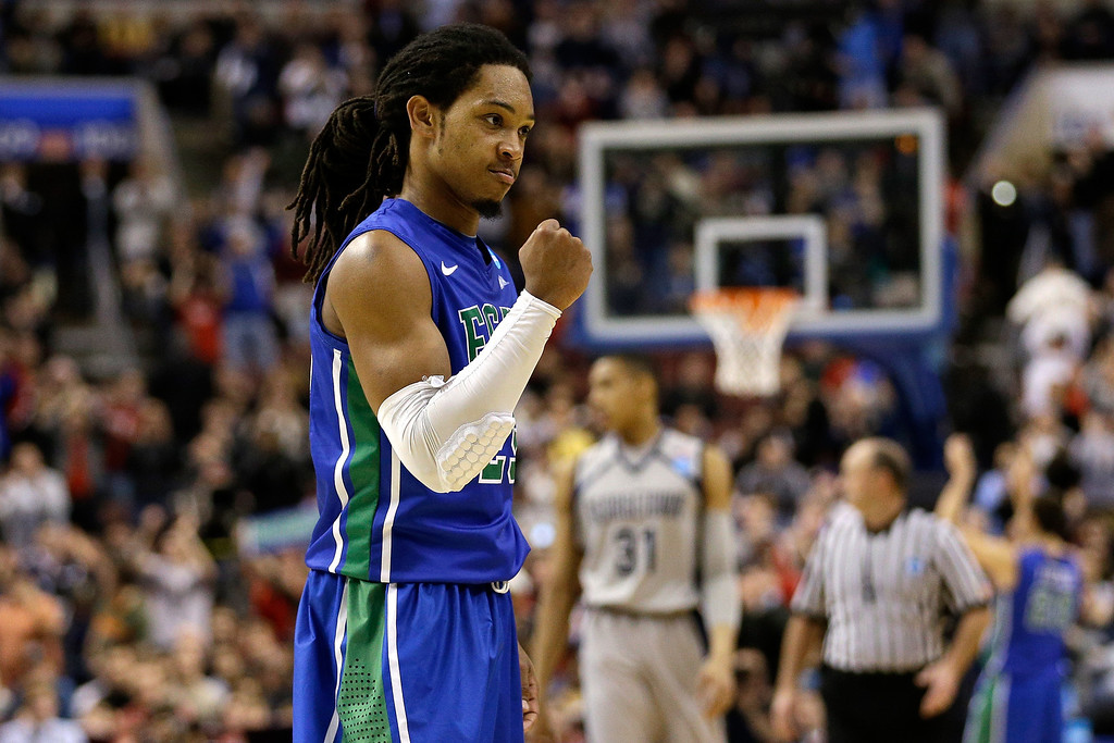 . PHILADELPHIA, PA - MARCH 22:  Sherwood Brown #25 of the Florida Gulf Coast Eagles celebrates late in the second half against the Georgetown Hoyas during the second round of the 2013 NCAA Men\'s Basketball Tournament at Wells Fargo Center on March 22, 2013 in Philadelphia, Pennsylvania.  (Photo by Rob Carr/Getty Images)