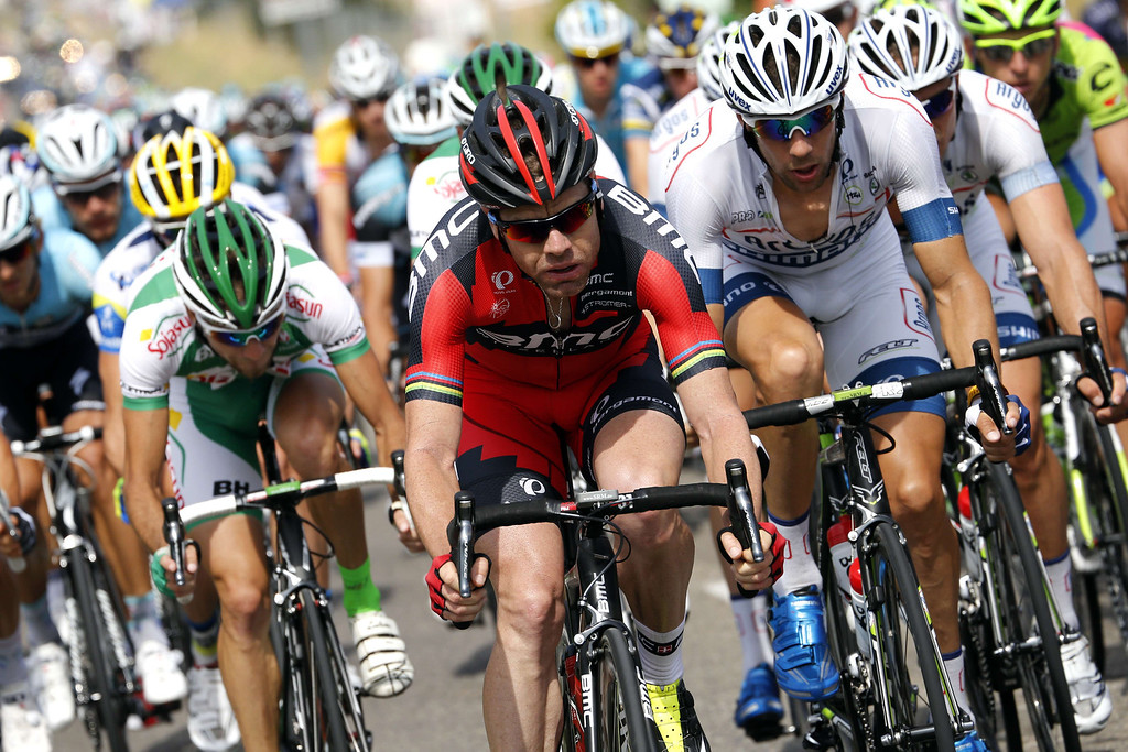. Australia\'s Cadel Evans (C) rides in the pack during the 228.5 km fifth stage of the 100th edition of the Tour de France cycling race on July 3, 2013 between Cagnes-sur-Mer and Marseille, southern France.  AFP PHOTO / JOEL  SAGET/AFP/Getty Images