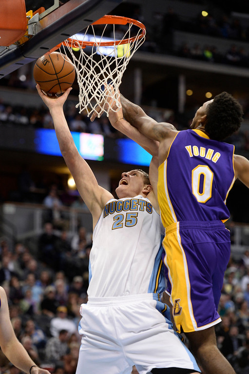 . DENVER, CO - NOVEMBER 13: Denver Nuggets center Timofey Mozgov (25) goes up for a shot as Los Angeles Lakers small forward Nick Young (0) attempts to block it during the second quarter November 13, 2013 at Pepsi Center. (Photo by John Leyba/The Denver Post)