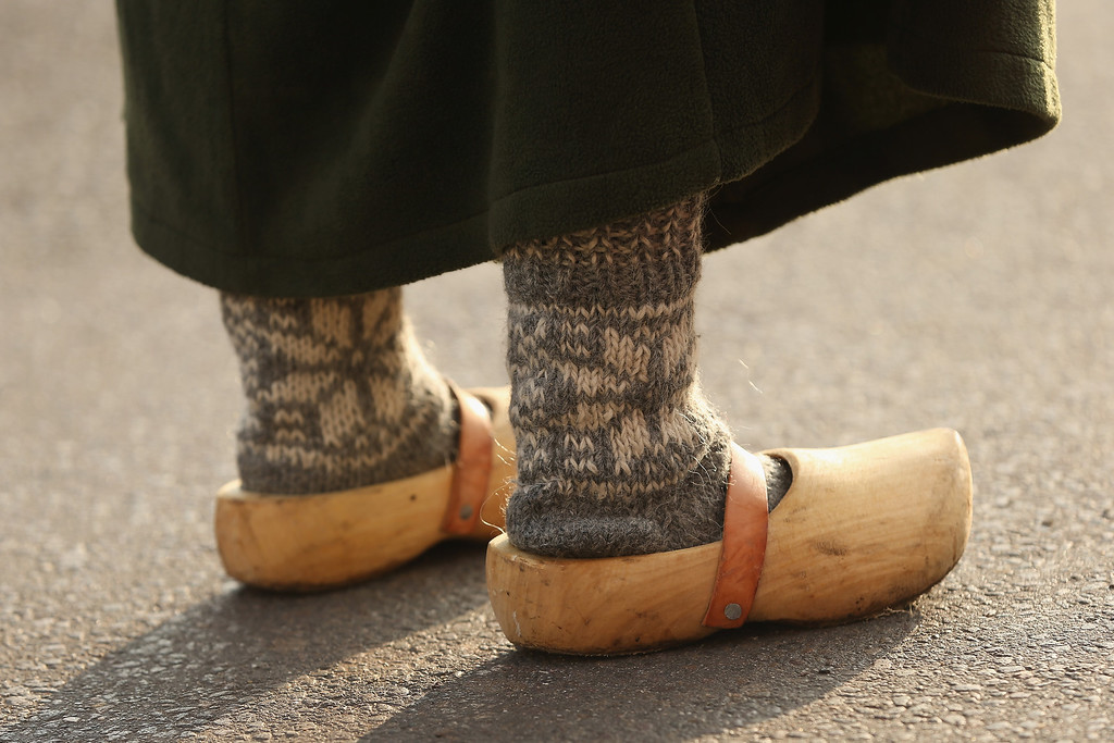 . A young local woman dressed in early-19th century regional period clothing and wearing wooden clogs walks through a recreated 1813 village in Liebertwolkwitz district during events to commemorate the 200th anniverary of The Battle of Nations on October 16, 2013 in Leipzig, Germany.  (Photo by Sean Gallup/Getty Images)