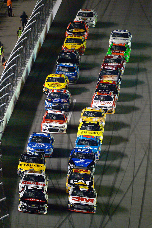. Austin Dillon (3) and Greg Biffle (16) lead the field to the green flag for the start of the first of two NASCAR Sprint Cup qualifying auto races at Daytona International Speedway in Daytona Beach, Fla., Thursday, Feb. 20, 2014. (AP Photo/Phelan M. Ebenhack)