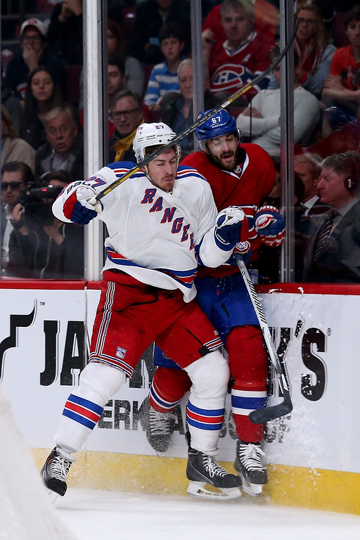 . MONTREAL, QC - MAY 17:  Ryan McDonagh #27 of the New York Rangers checks Max Pacioretty #67 of the Montreal Canadiens in the first period in Game One of the Eastern Conference Finals of the 2014 NHL Stanley Cup Playoffs at the Bell Centre on May 17, 2014 in Montreal, Canada.  (Photo by Bruce Bennett/Getty Images)