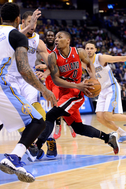 . DENVER, CO - APRIL 14: Damian Lillard (0) of the Portland Trail Blazers drives against the Denver Nuggets during the second half of action. The Denver Nuggets defeat the Portland Trail Blazers 118-109 at the Pepsi Center. (Photo by AAron Ontiveroz/The Denver Post)