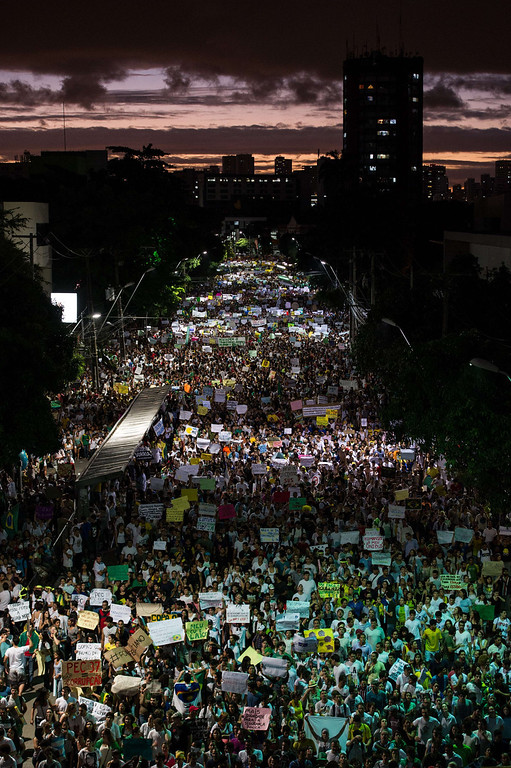 . Thousands of people march in the center of Recife, state of Pernambuco, Brazil, on June 20, 2013, during a protest of what is now called the \'Tropical Spring\' against corruption and price hikes.   AFP PHOTO / YASUYOSHI CHIBA/AFP/Getty Images
