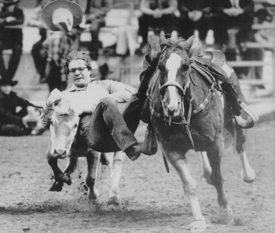 . Horn Lock -- Dave Gamblin of Whealand, Wyoming loses his hat as he grabs a hold of a steer during the first round of steer wrestling at the National Western Stock Show rodeo competition in Denver Monday. The show officially opens its livestock judging and rodeo Wednesday morning. 1987. AP Laserphoto