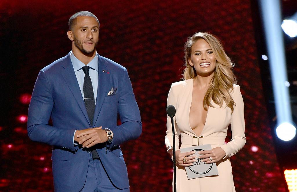 . Colin Kaepernick, left, and Chrissy Teigen present the award for best female athlete at the ESPY Awards at the Nokia Theatre on Wednesday, July 16, 2014, in Los Angeles. (Photo by John Shearer/Invision/AP)