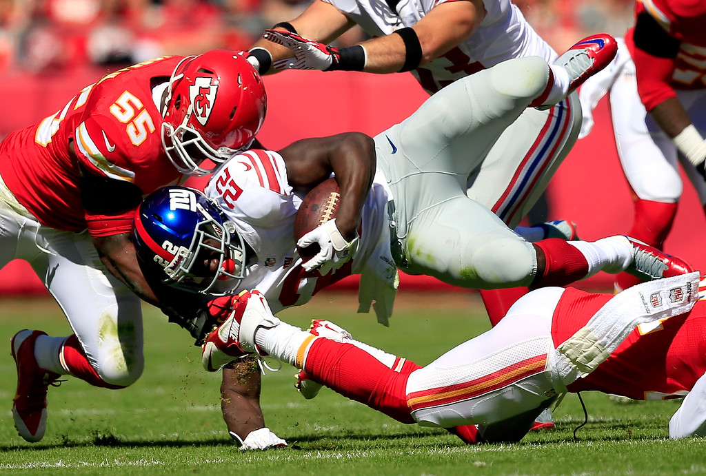 . KANSAS CITY, MO - SEPTEMBER 29:  Running back David Wilson #22 of the New York Giants is tackled by inside linebacker Akeem Jordan #55 and cornerback Dunta Robinson #21 of the Kansas City Chiefs during the game at Arrowhead Stadium on September 29, 2013 in Kansas City, Missouri.  (Photo by Jamie Squire/Getty Images)