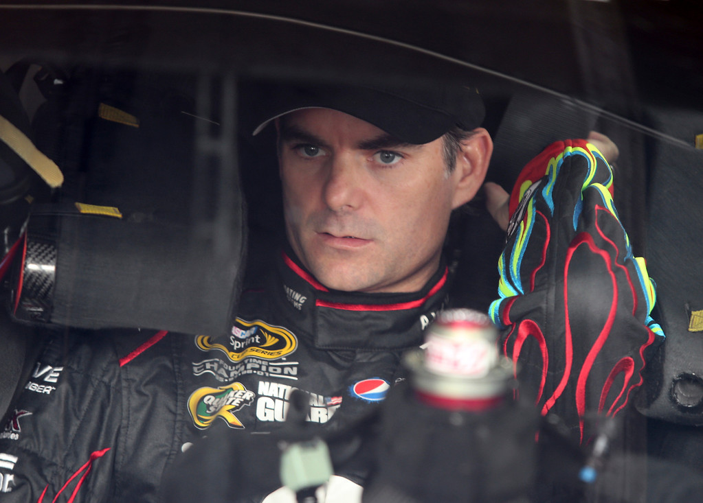 . Jeff Gordon prepares for practice for Saturday\'s NASCAR Sprint Cup series auto race at Charlotte Motor Speedway in Concord, N.C., Friday, Oct. 11, 2013. (AP Photo/Bob Jordan)
