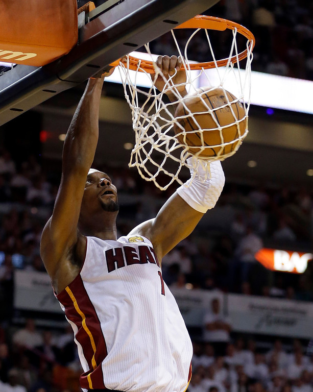 . Miami Heat center Chris Bosh dunks against the San Antonio Spurs in the first half in Game 3 of the NBA basketball finals, Tuesday, June 10, 2014, in Miami. (AP Photo/Wilfredo Lee)