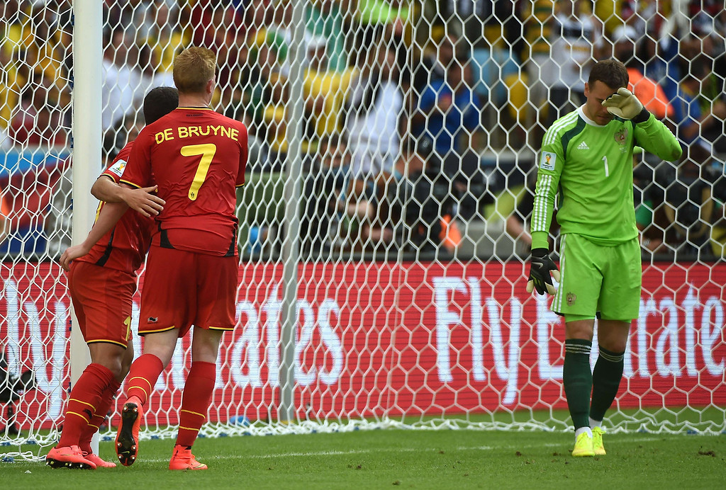 . (L to R) Belgium\'s midfielder Eden Hazard and midfielder Kevin De Bruyne celebrate the goal against Russia next to Russia\'s goalkeeper Igor Akinfeev,  during a Group H football match between Belgium and Russia at the Maracana Stadium in Rio de Janeiro during the 2014 FIFA World Cup on June 22, 2014.  AFP PHOTO / CHRISTOPHE SIMON