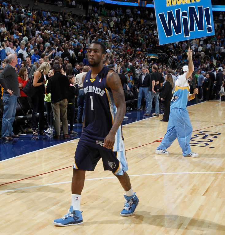 . Memphis Grizzlies guard Tony Wroten heads off the court after the Denver Nuggets\' 87-80 victory in an NBA basketball game in Denver, Friday, March 15, 2013. (AP Photo/David Zalubowski)