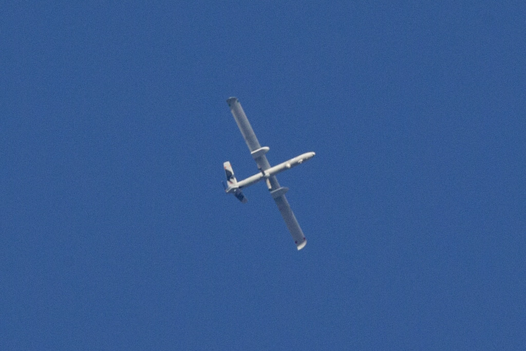 . A picture taken from the southern Israeli Gaza border shows an Israeli army UAV flying over the Gaza strip on July 29, 2014. Bloodshed in war-torn Gaza surged with dozens more Palestinians killed as the conflict raged into a fourth week and Iran accused Israel of genocide in the tiny enclave. AFP PHOTO / JACK  GUEZ/AFP/Getty Images