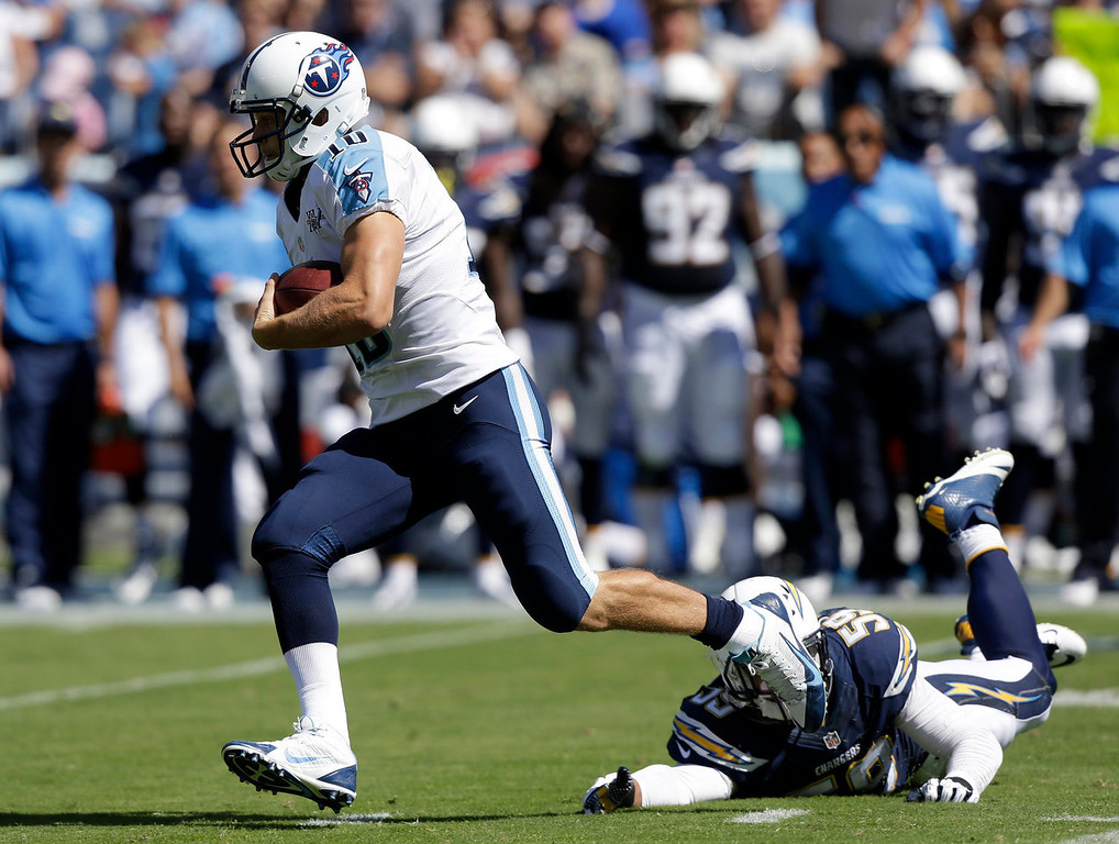 . Tennessee Titans quarterback Jake Locker (10) leaves San Diego Chargers linebacker Andrew Gachkar (59) behind while running for a 39-yard gain in the first quarter of an NFL football game on Sunday, Sept. 22, 2013, in Nashville, Tenn. (AP Photo/Wade Payne)